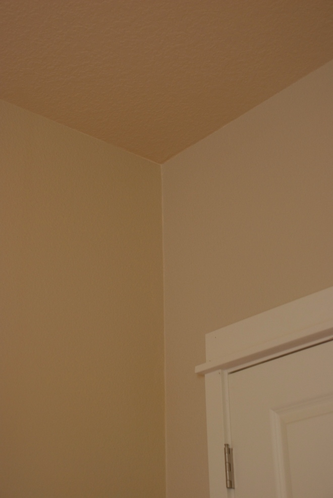 Ceiling is the Builder's Color, the Right is Glidden's Water Chestnut and the Left is Glidden's Whispering Wheat