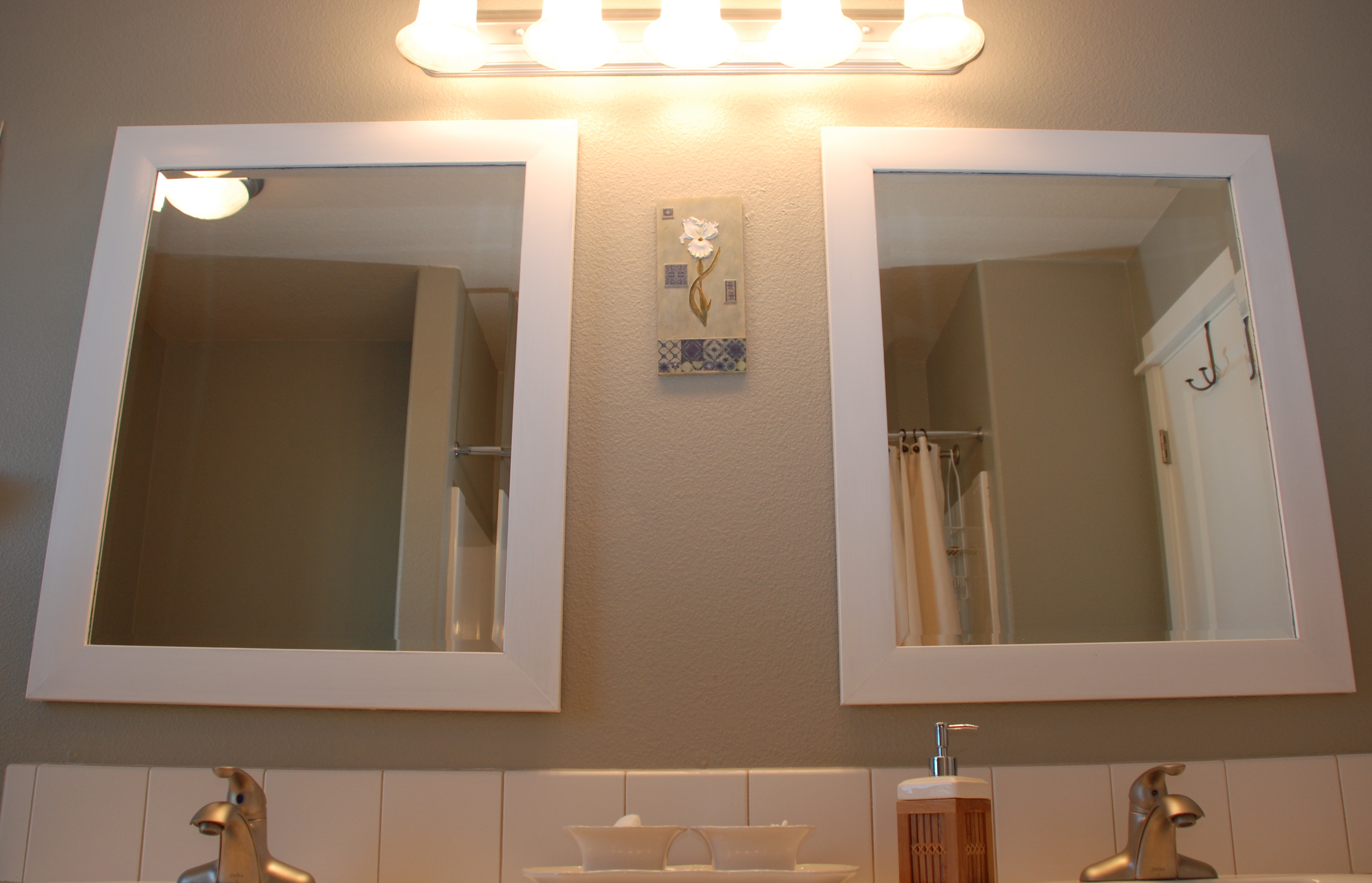 Before after bliss our guest bath mini makeover tell for Bathroom 2 light fixtures