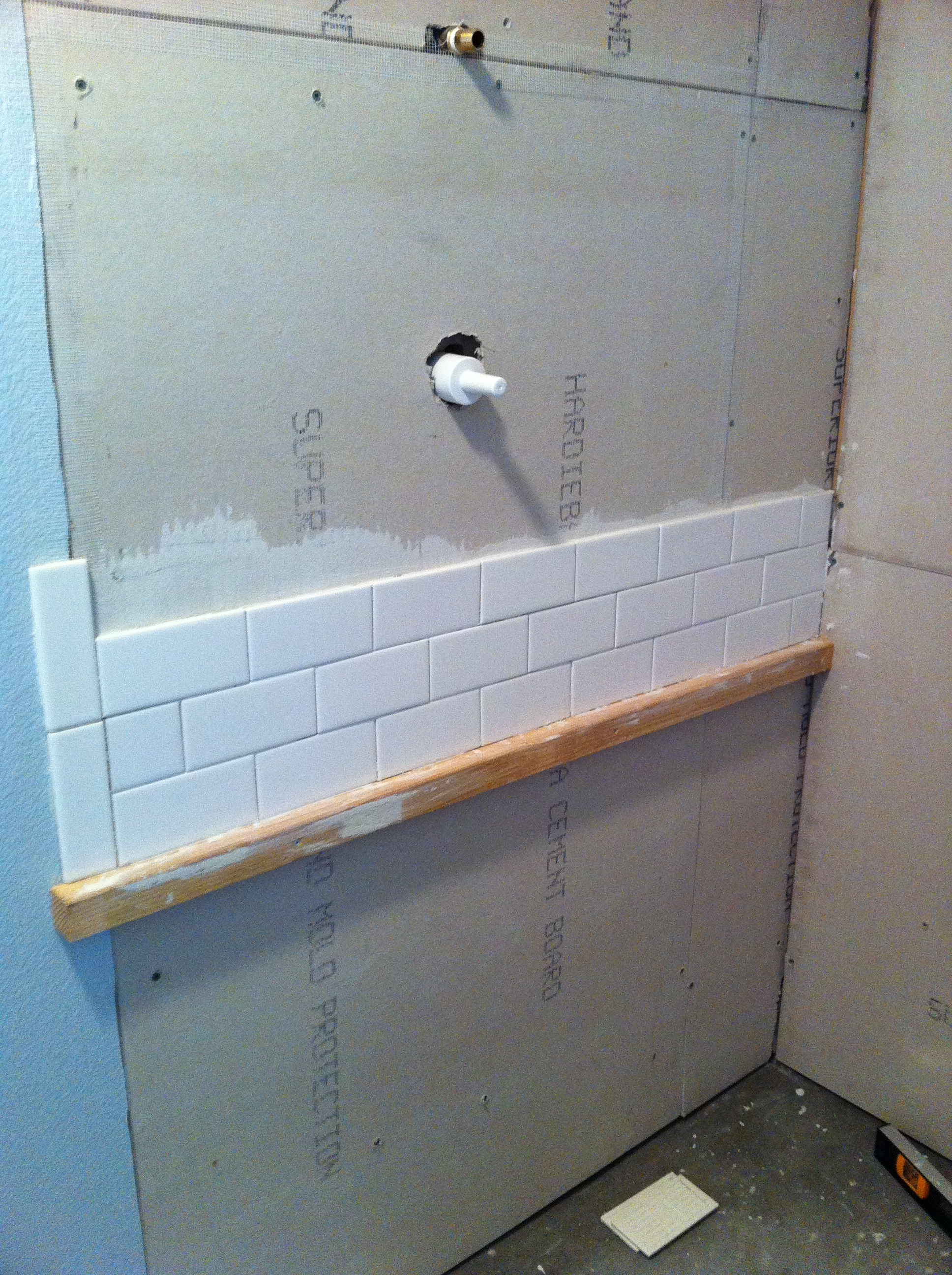 Subway tile teller all about it a teaser photo subway tile installation commences dailygadgetfo Image collections